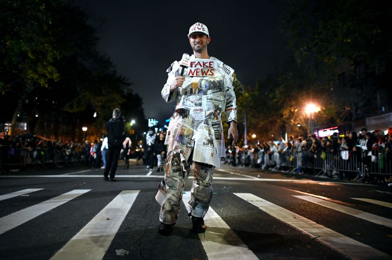 "A man dressed as ""Fake News Media"" participates in the annual Village Halloween parade on Sixth Avenue in New York on Oct. 31."