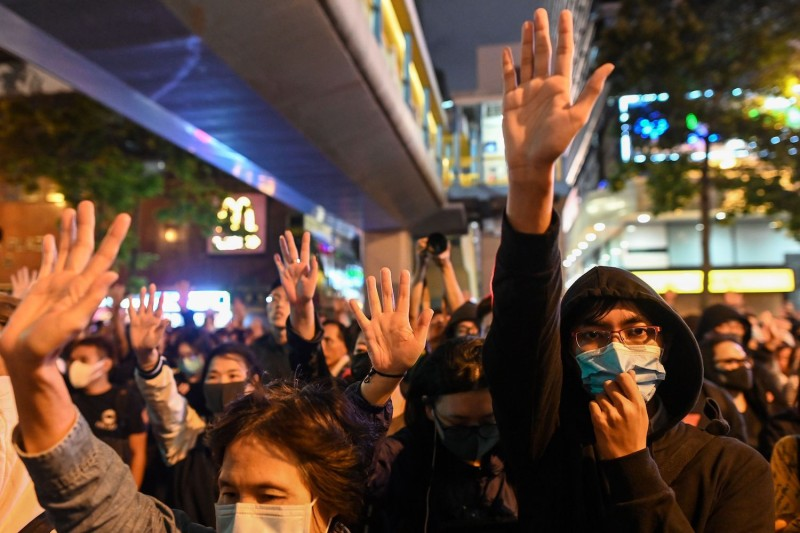 Protesters in Hong Kong chant slogans near a police-cordoned area to show support for a small group of protesters barricaded inside the Hong Kong Polytechnic University.