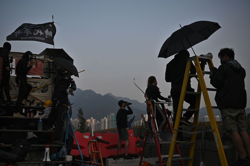 Protesters stand on a bridge over the Tolo Highway at the Chinese University of Hong Kong (CUHK) on Nov. 13.