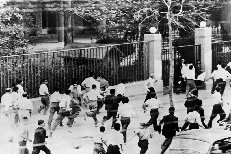 Rioters run in the streets of Tehran in August 1953.