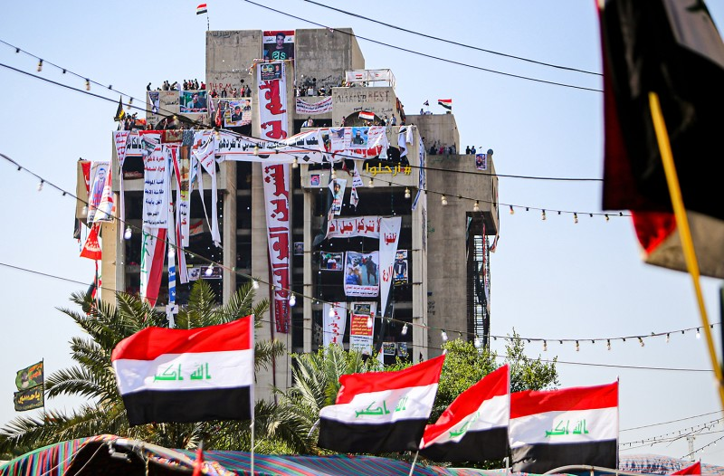 Banners cover an abandoned high-rise building in Baghdad on Nov. 6.