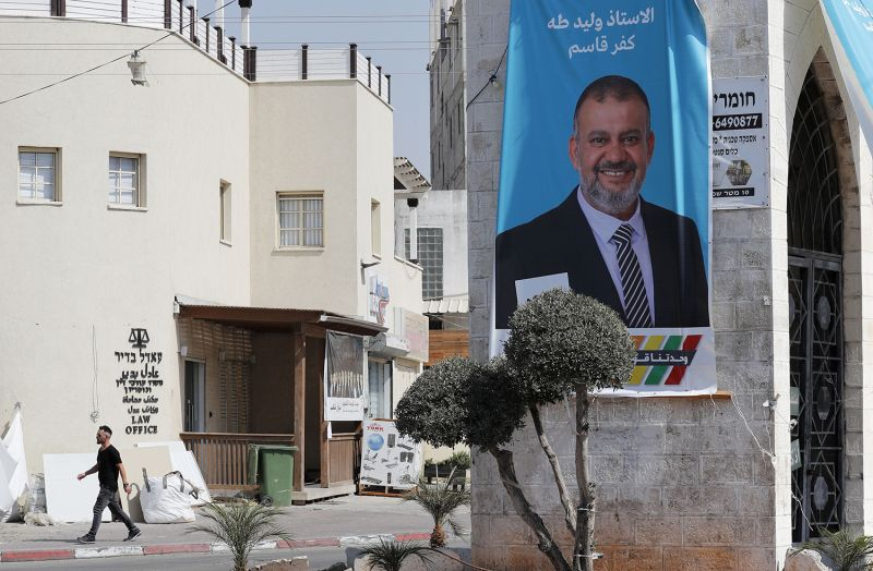 An election banner with a portrait of Arab Israeli candidate Waleed Taha