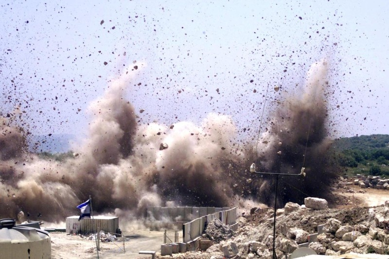 Smoke rises from an Israeli army post blown away by army engineers near the town of Zarit on the Israeli-Lebanese border on May 16, 2000, as part of the preparation for an Israeli withdrawal from Lebanon.