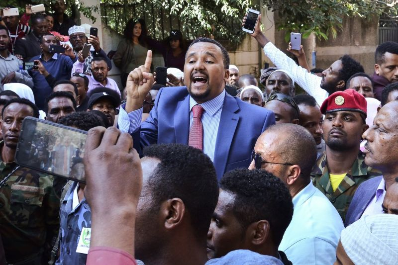 Jawar Mohammed, a member of the Oromo ethnic group who has been a public critic of Prime Minister Abiy Ahmed, addresses supporters outside his home in the Ethiopian capital, Addis Ababa, on Oct. 24, a day after his supporters took to the streets, burning tires and blocking roads following rumors of Jawar's mistreatment by security forces.