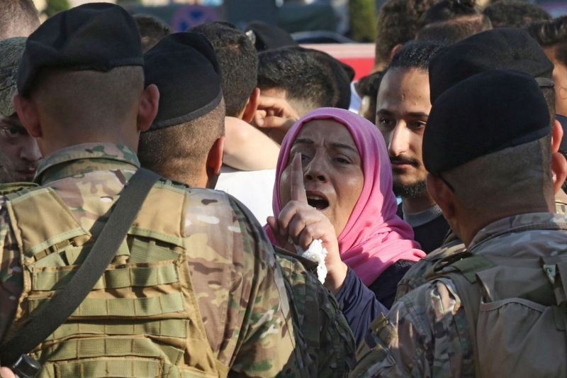 A Lebanese protester confronts soldiers during ongoing anti-government demonstrations in Lebanon's southern city of Sidon on Nov. 1.