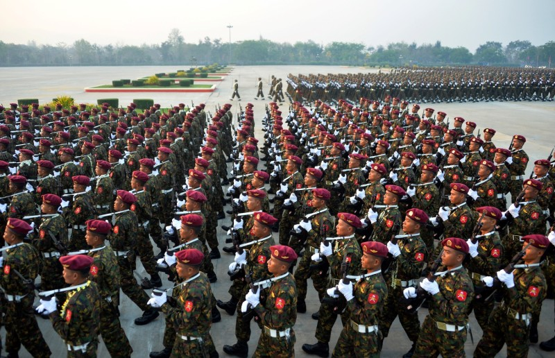 Members of the Myanmar military march in formation during a parade to mark the country's 74th Armed Forces Day in Naypyidaw on March 27.