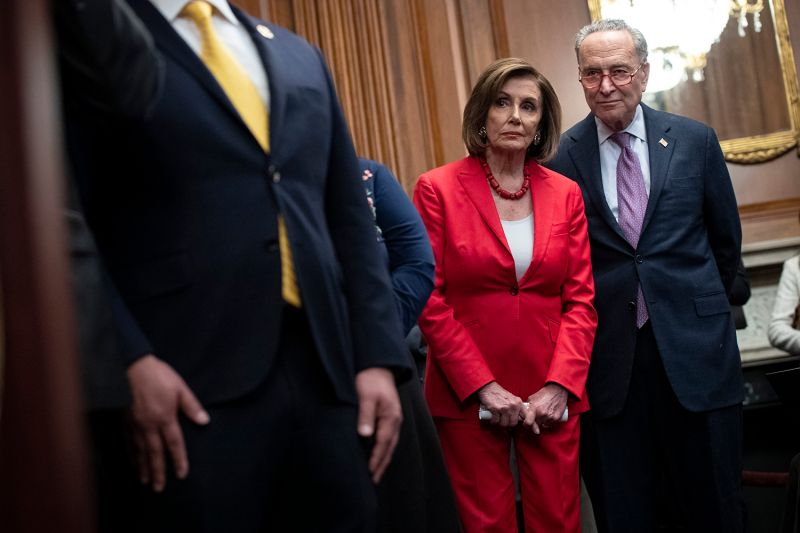 Speaker of the U.S. House Nancy Pelosi and Senate Minority Leader Chuck Schumer look on at a press conference at the U.S. Capitol on Nov. 12.