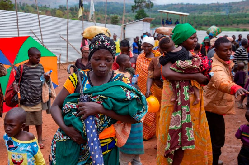 Nzeyimana Consolate arrives carrying her baby at the Nyabitara transit site, among other Burundian refugees, on Oct. 3, 2019 in Ruyigi, Burundi. Nearly 600 Burundians who fled political violence in their home country to Tanzania were repatriated voluntarily, the U.N. refugee agency  said.