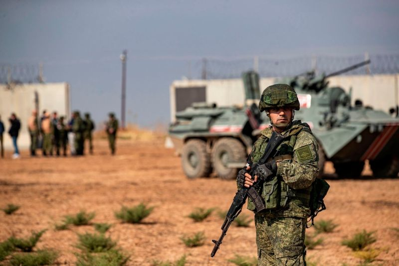 A Russian soldier stands guard during a joint patrol with Turkish forces in the countryside of Darbasiyah, Syria.