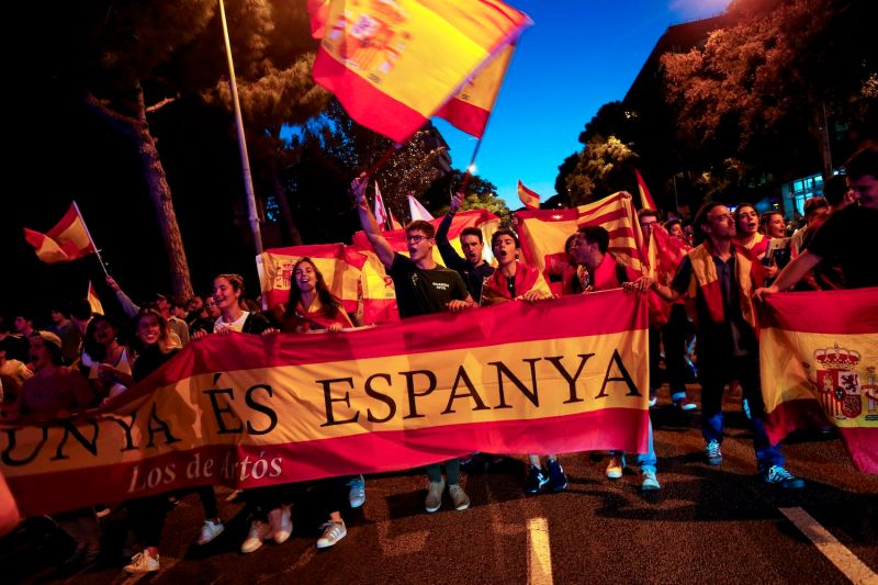 Pro-Spain protesters wave Spanish flags during a demonstration against independence in Catalonia  in Barcelona on Oct. 3, 2018.