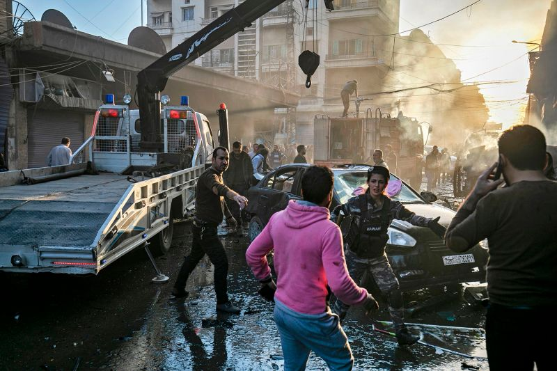 Syrian security forces stop civilians from approaching the site of an explosion in Qamishli in northeastern Syria on Nov. 11.