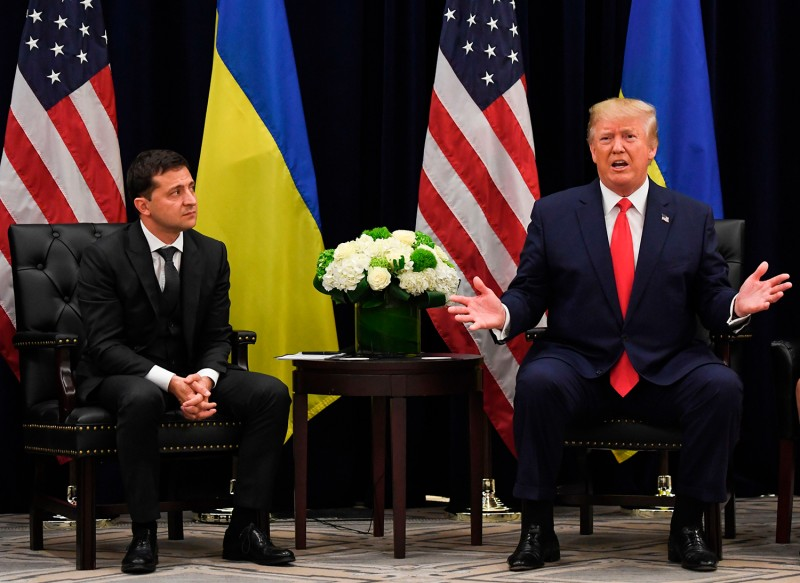 U.S. President Donald Trump speaks as Ukrainian President Volodymyr Zelensky looks on during a meeting in New York on Sept. 25.