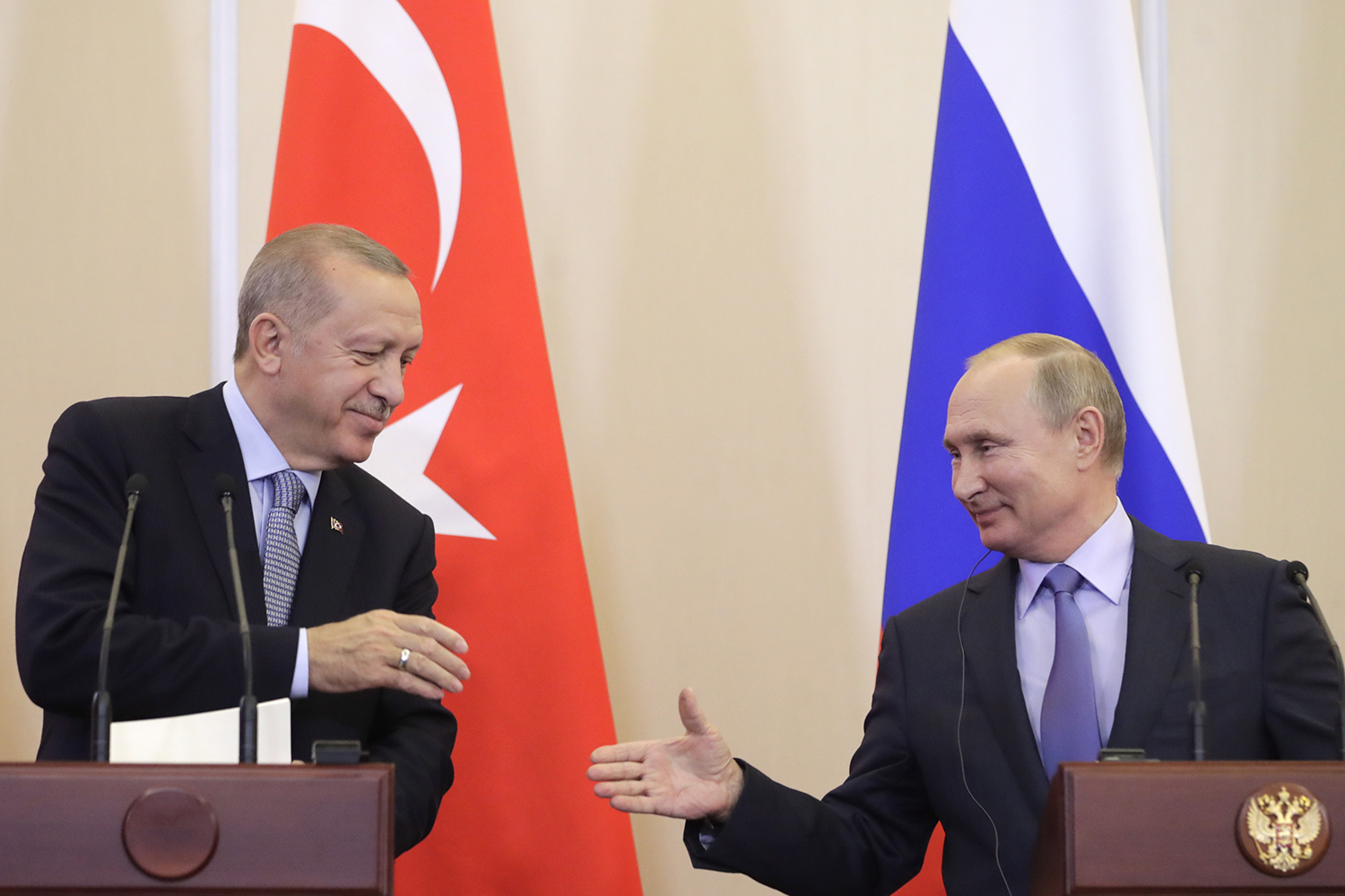 Turkey's President Recep Tayyip Erdogan and Russian President Vladimir Putin shake hands a joint news conference on Syria following their meeting in Sochi, Russia on Oct. 22.