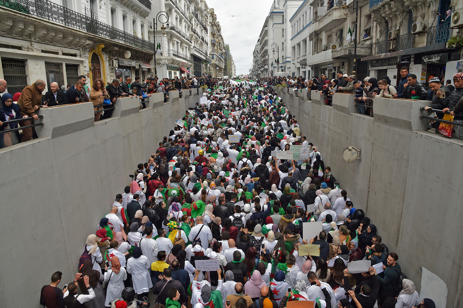 ALGERIA | A crowd of people take part in a demonstration against then-President Abdelaziz Bouteflikain in the capital Algiers  on March 19. RYAD KRAMDI/AFP via Getty Images