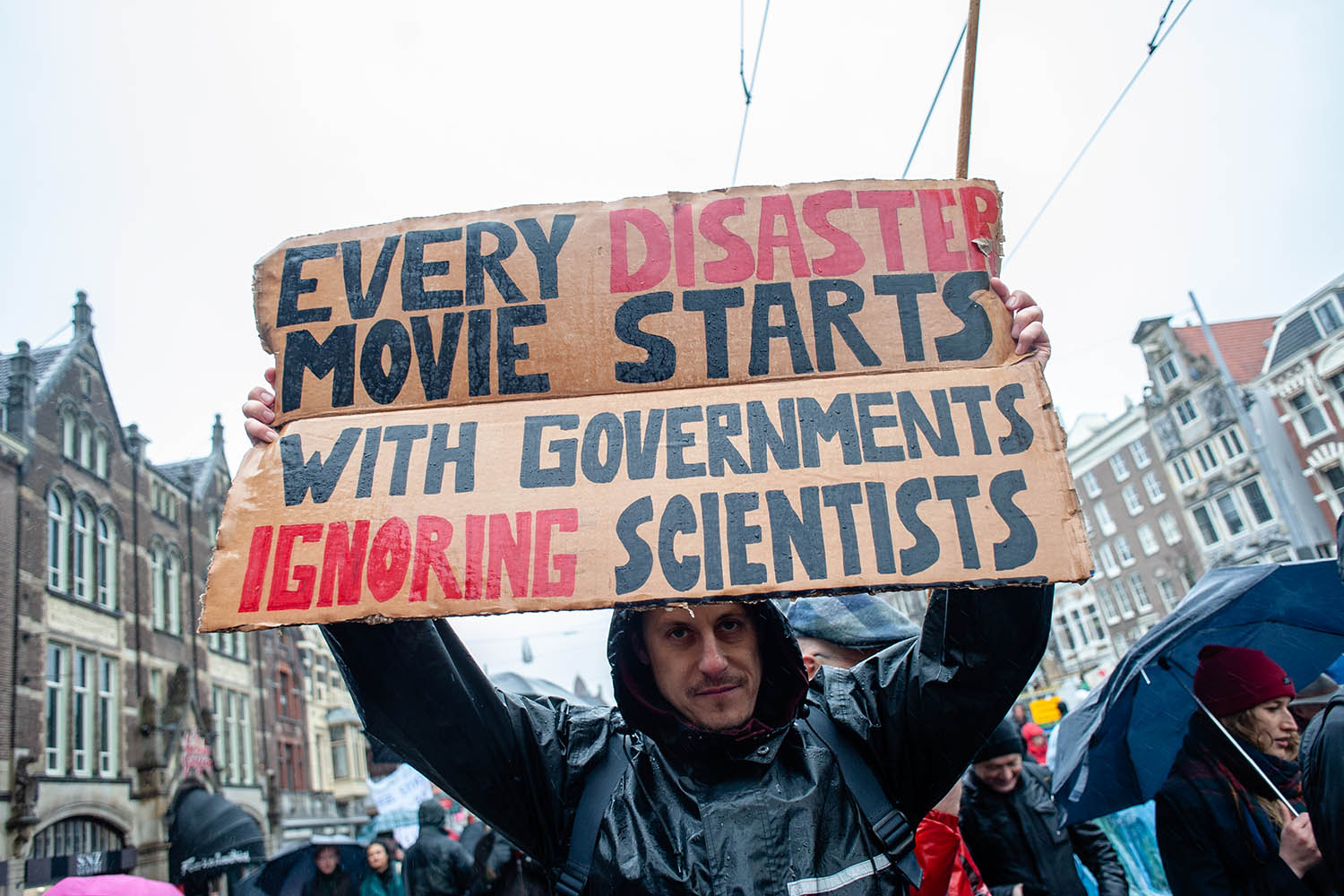 A demonstrator holds a sign during a climate strike in Amsterdam's Dam Square on March 10. Thousands of people gathered to demand affordable green energy.