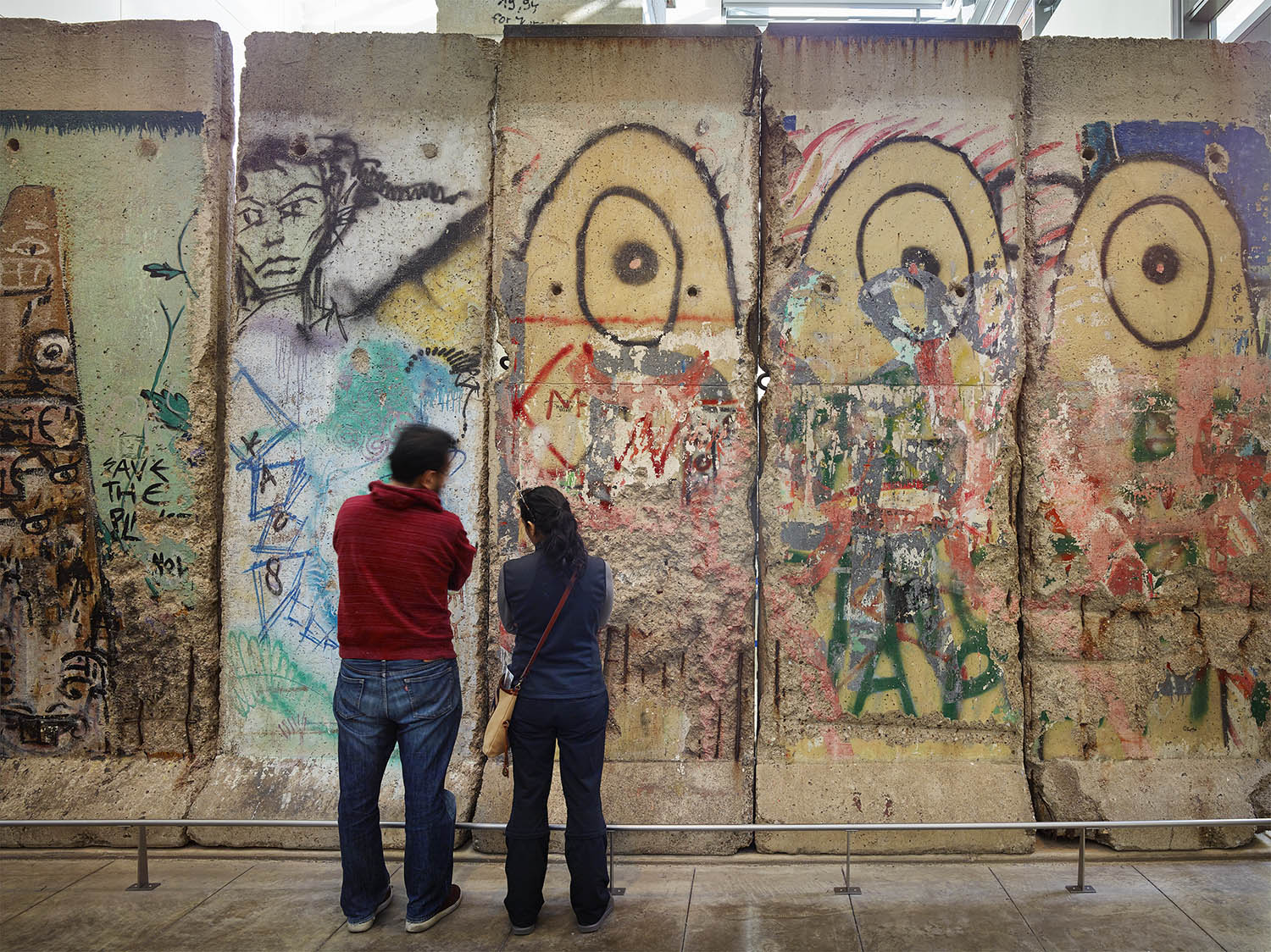 Visitors view a section of the Berlin Wall at the Newseum in December.