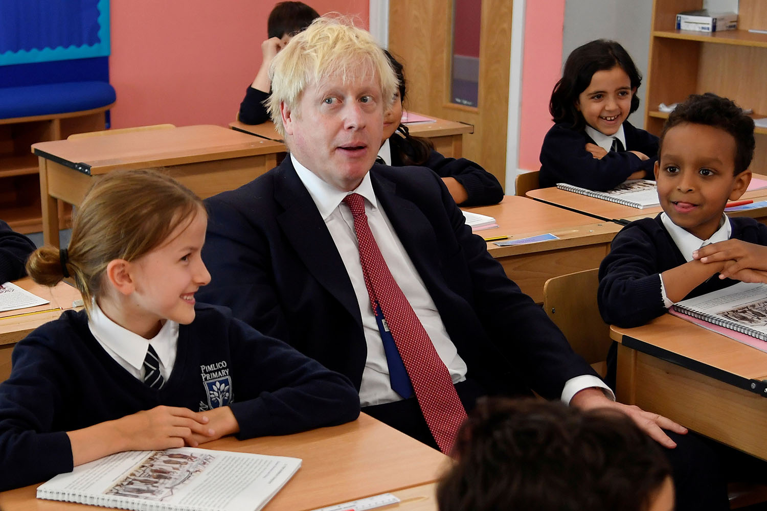 Britain's Prime Minister Boris Johnson attends a class during his visit to Pimlico Primary school in London on Sept. 10. TOBY MELVILLE/AFP via Getty Images