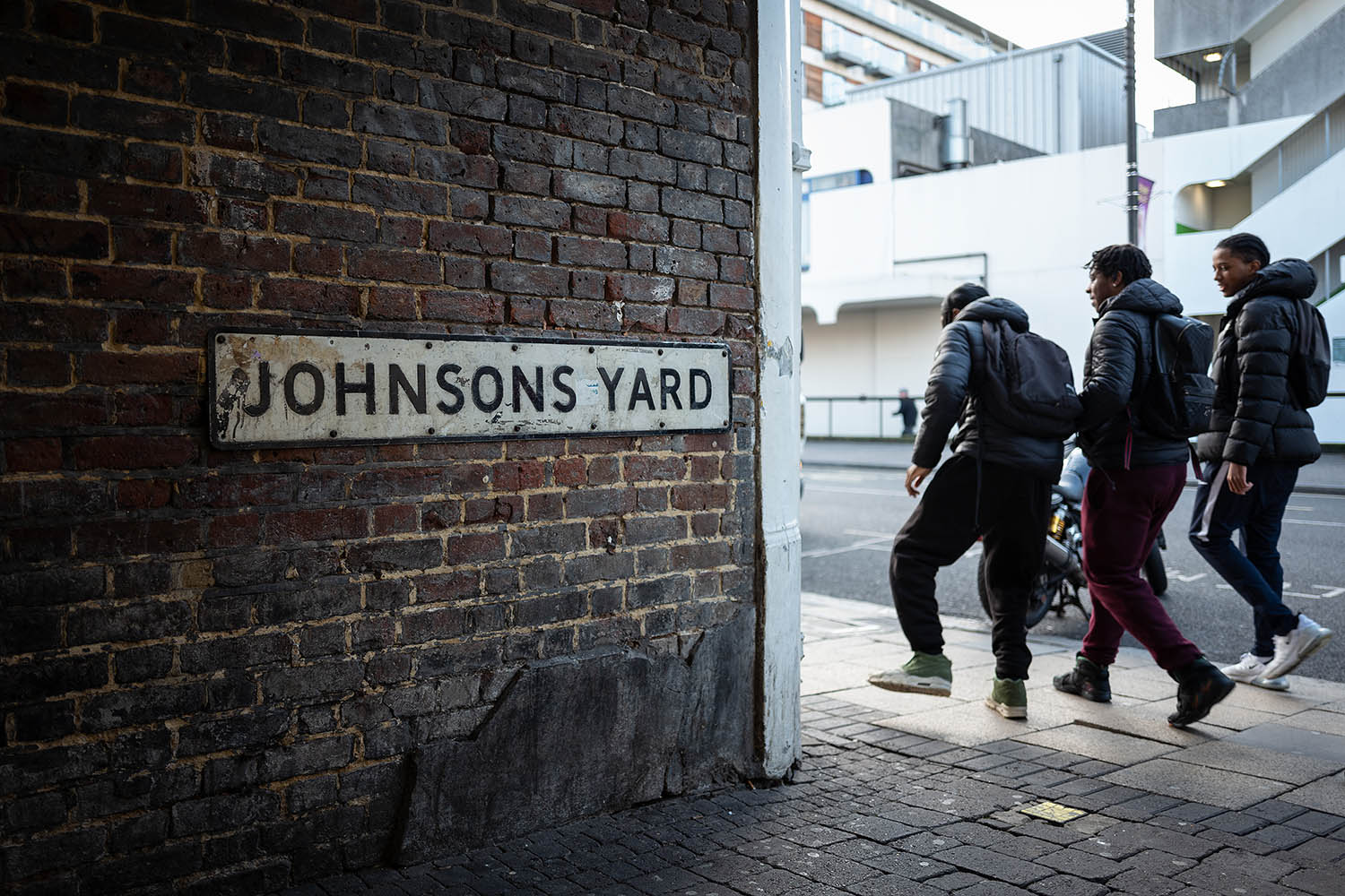 A group of young men walk past Johnsons Yard in Uxbridge, London, on Dec. 9.