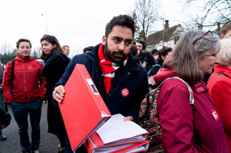 Ali Milani, the British Labour Party's parliamentary candidate in Uxbridge and South Ruislip, speaks to campaign volunteers before canvassing in the Eastcote area of London on Dec. 7.