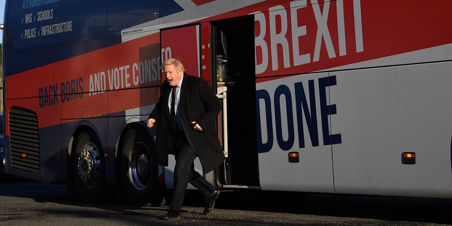 "Johnson alights from the ""battle bus"" as he arrives for a campaign visit to Fergusons Transport in Washington, west of Sunderland, northeast England, on Dec. 9."