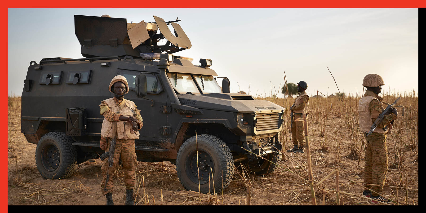 A group of soldiers from the Burkina Faso Army patrols a rural area during a joint operation with the French Army in the Soum region along the border with Mali on Nov. 9.