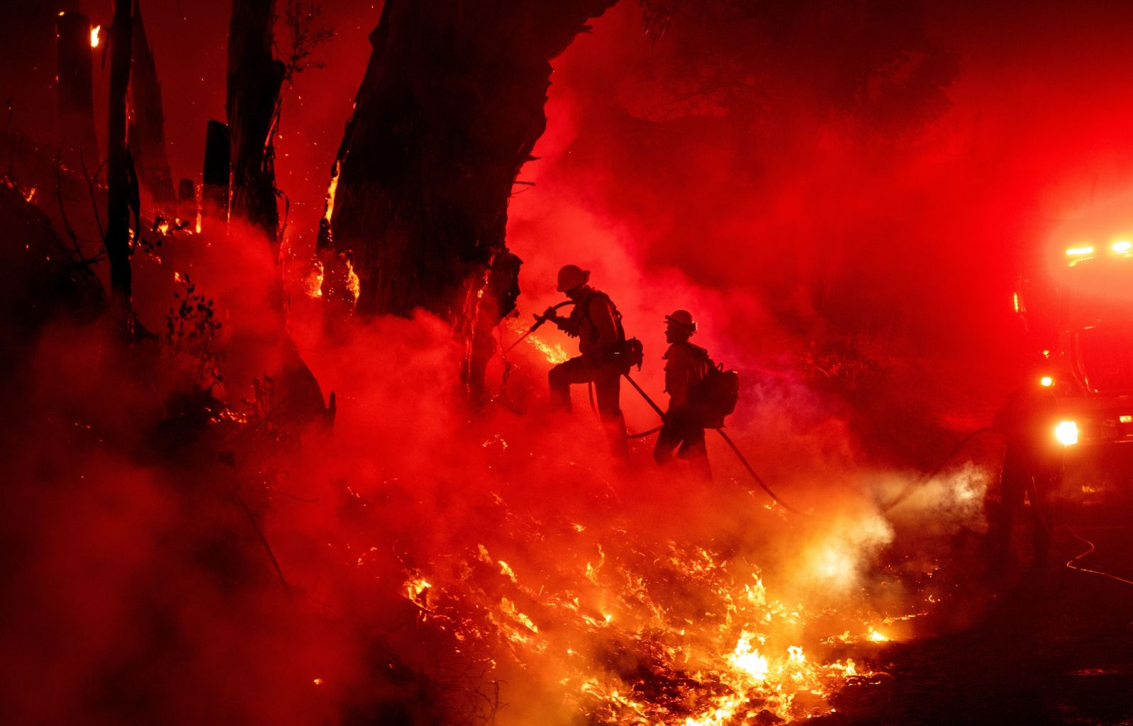 Firefighters work to control flames from a backfire during the Maria fire in Santa Paula, California, on Nov. 1. JOSH EDELSON/AFP via Getty Images