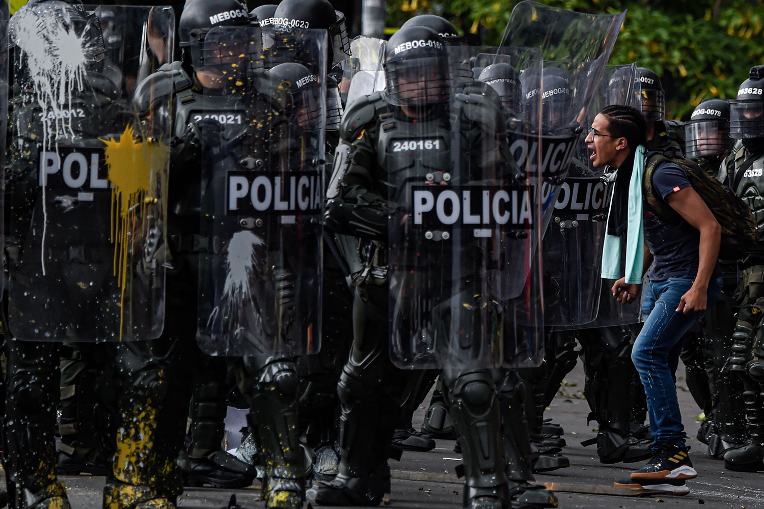 A demonstrator shouts at riot police during a nationwide strike called by students, unions, and indigenous groups to protest the government of Colombia's President Ivan Duque, in Bogota, on Nov. 21. JUAN BARRETO/AFP via Getty Images