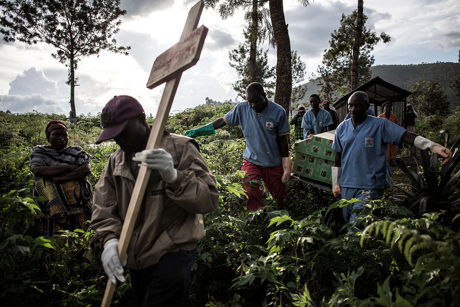 Health workers carry a coffin containing a victim of the Ebola virus in Butembo, the Democratic Republic of Congo, on May 16. The city is at the epicenter of the Ebola crisis with the toll of this outbreak at more than 1,000 deaths. JOHN WESSELS/AFP/Getty Images