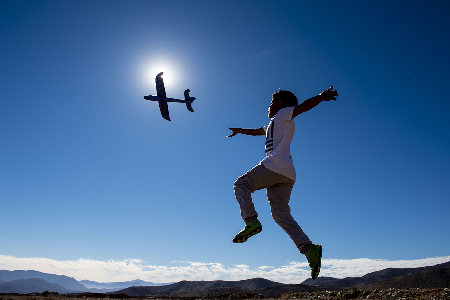 A boy plays with a toy plane on the eve of a solar eclipse in La Higuera in the Atacama desert north of Santiago, Chile, on July 1. MARTIN BERNETTI/AFP/Getty Images
