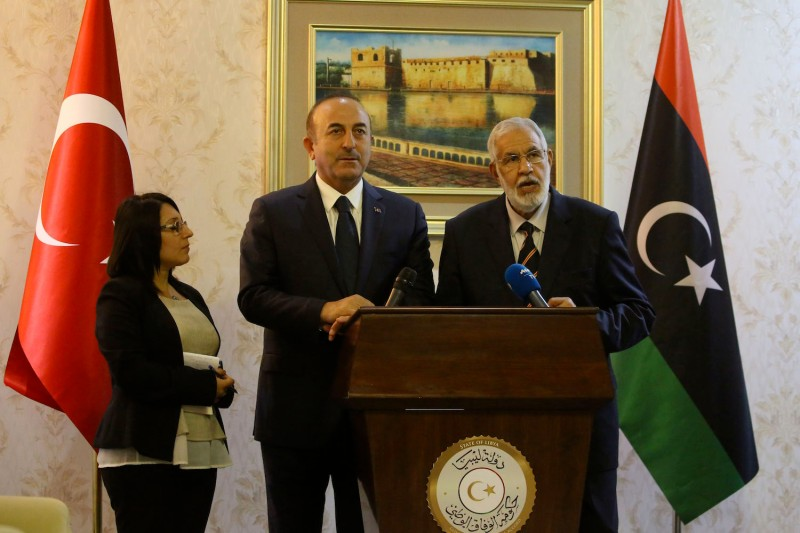 Libyan Foreign Minister Mohamed Taher Siala, left, and his Turkish counterpart, Mevlut Cavusoglu