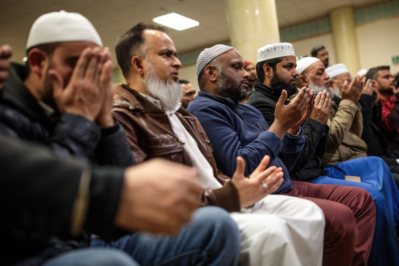Muslims attend a vigil at the East London Mosque for the victims of the New Zealand mosque attacks on March 15 in London, England.