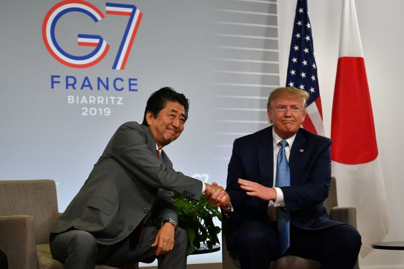 U.S. President Donald Trump shakes hands with Japanese Prime Minister Shinzo Abe