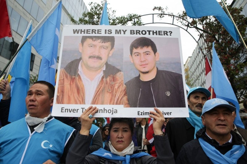 Protesters take part in a rally in support of Uighurs in Brussels on Oct. 1.