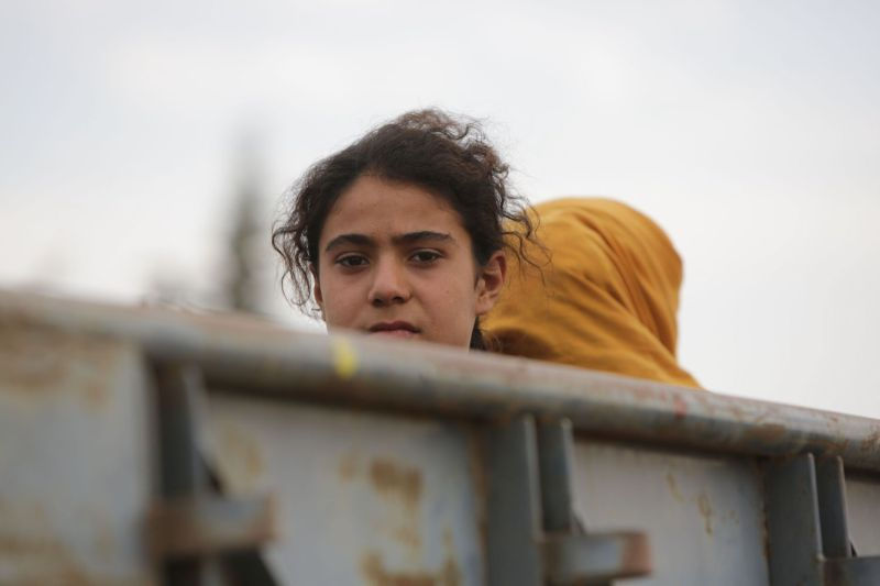 Syrian civilians flee villages amid fighting in the countryside of Tal Abyad