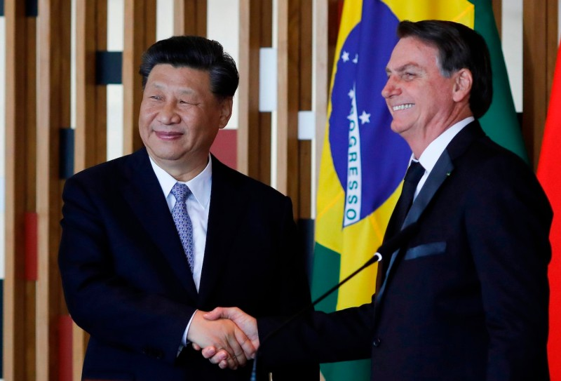 Chinese President Xi Jinping and Brazilian President Jair Bolsonaro shake hands after their bilateral meeting in Brasília, Brazil, on Nov. 13.