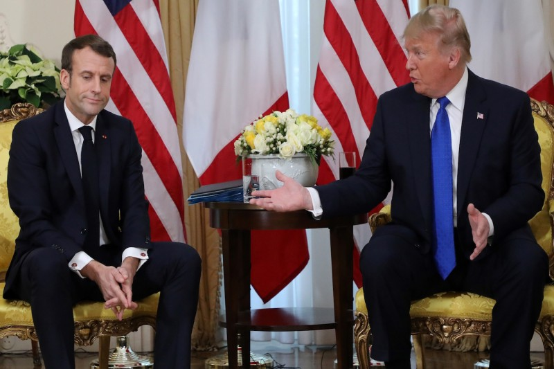 U.S. President Donald Trump and French President Emmanuel Macron meet on the sidelines of the NATO summit in London on Dec. 3.