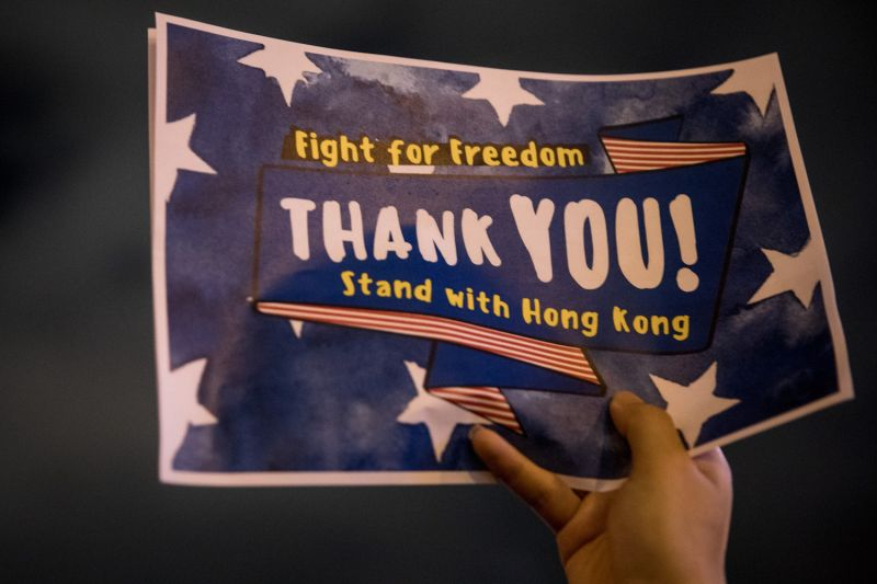 A pro-democracy protester holds a thank-you sign during a Thanksgiving Day rally at Edinburgh Place in Hong Kong on Nov. 28.