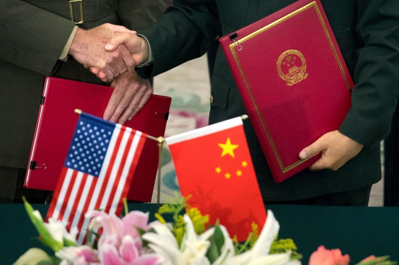 Gen. Joseph Dunford, the then-chairman of the U.S. Joint Chiefs of Staff, and then-Chief of the General Staff of the Chinese People's Liberation Army Fang Fenghui shake hands after signing an agreement at the Bayi Building in Beijing on Aug. 15, 2017.