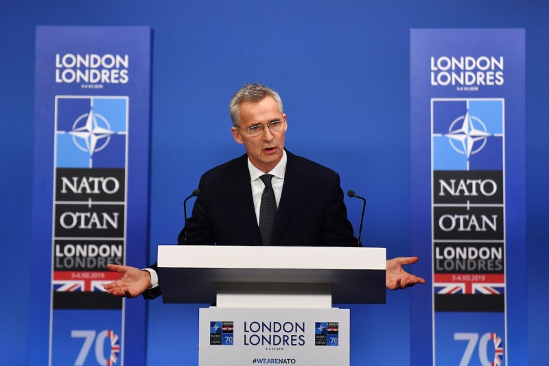 NATO Secretary-General Jens Stoltenberg talks at a press conference during the NATO summit in Hertford, England, on Dec. 4.