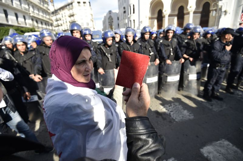 An Algerian protester holds up a red card during an anti-government demonstration in Algiers on Dec. 11.