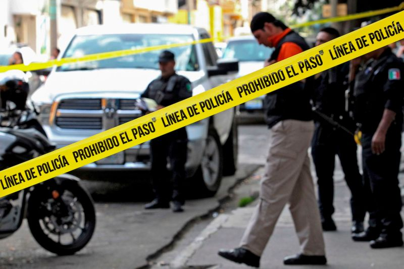 Policemen are seen at a crime scene in Guadalajara, Jalisco, on Nov. 22.