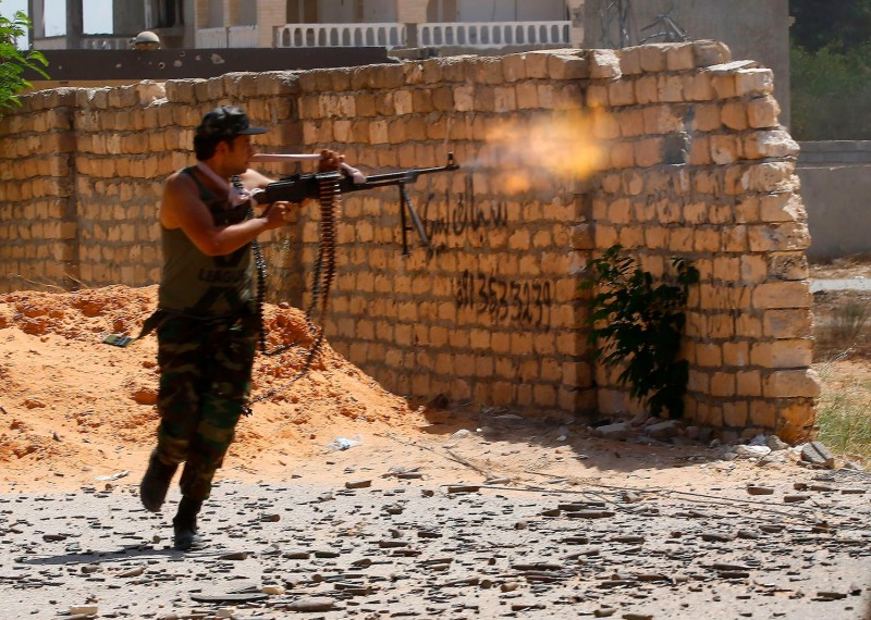 A fighter loyal to the internationally recognized Libyan Government of National Accord fires his gun during clashes with forces loyal to strongman Khalifa Haftar in Tripoli on Sept. 7.