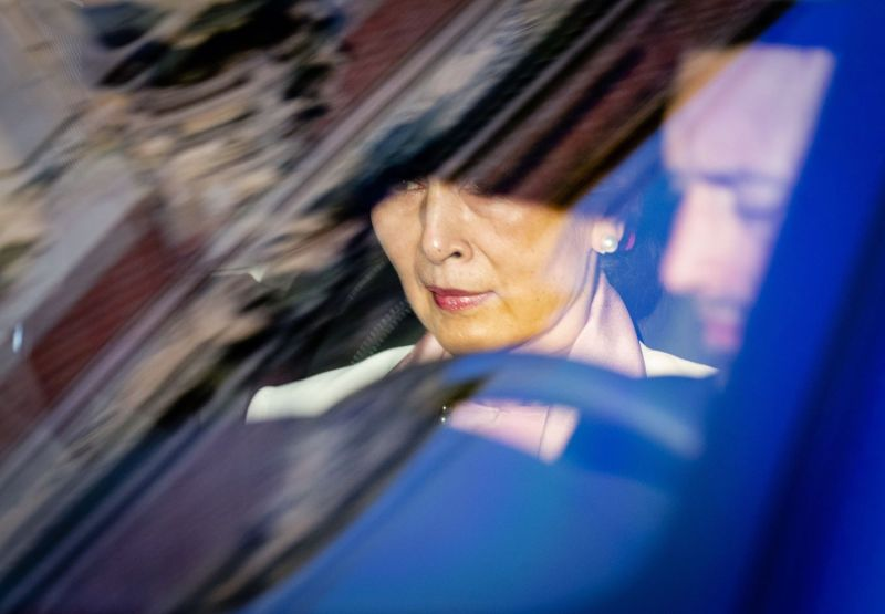 Aung San Suu Kyi arrives in a car on the last day of hearings in the Rohingya genocide case before the U.N. International Court of Justice in The Hague on Dec. 12.
