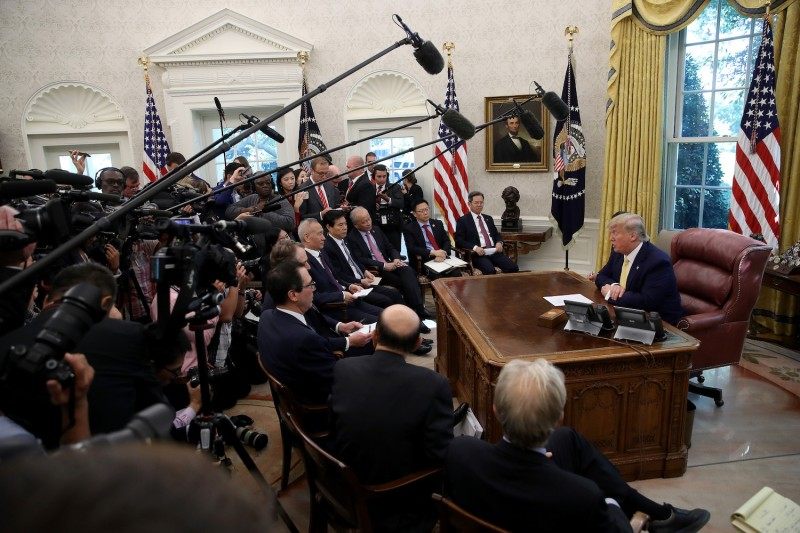 "U.S. President Donald Trump meets with Chinese Vice Premier Liu He and members of the U.S. and Chinese trade negotiation teams while announcing a ""phase one"" trade agreement with China at the White House on Oct. 11."