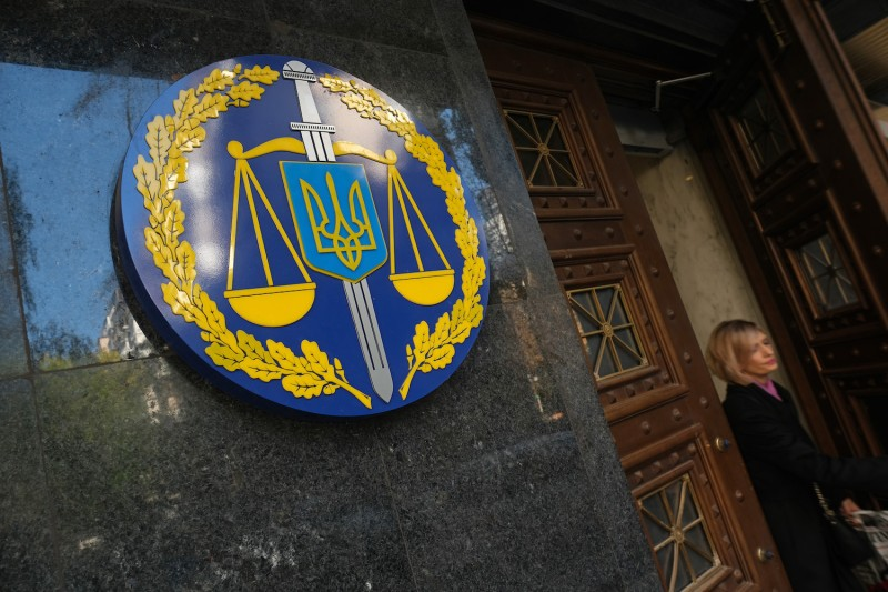 A woman leaves the offices of the Ukrainian General Prosecutor in Kyiv on Oct. 2.
