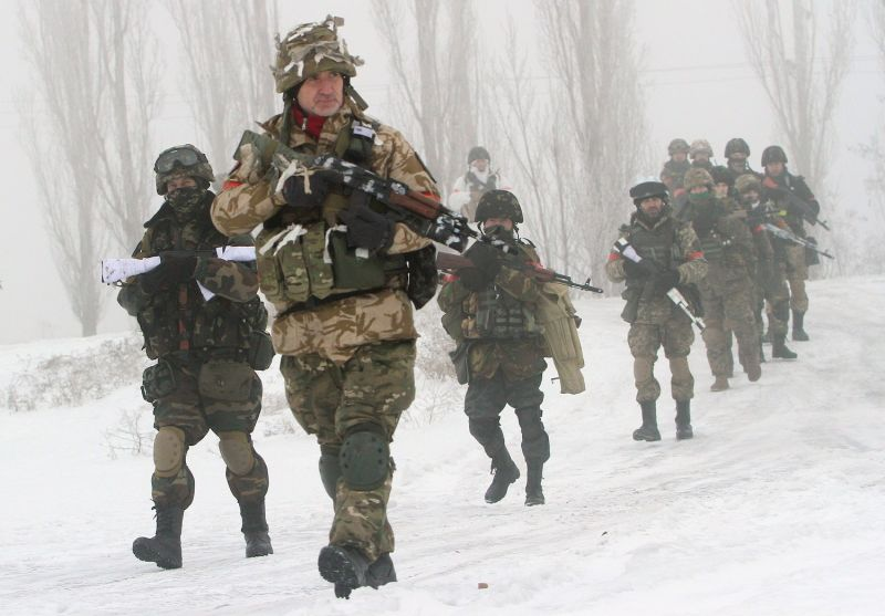 Ukrainian servicemen of the Donbass volunteer battalion take part in operations in a village in the Lysychansk district of the Luhansk region on Jan. 28, 2015.