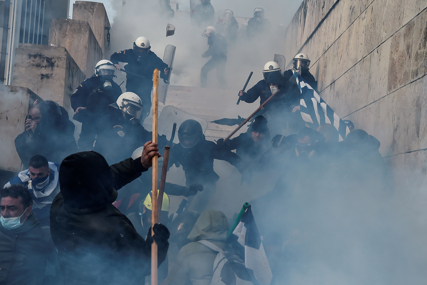 GREECE | Protesters clash with police during a demonstration against an agreement with Skopje to rename the neighboring country Macedonia as the Republic of North Macedonia, in Athens on Jan. 20. LOUISA GOULIAMAKI/AFP via Getty Images