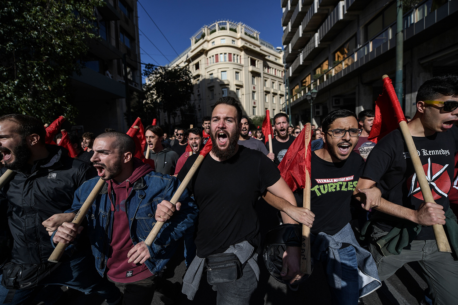GREECE | Students shout slogans as they demonstrate against recent educational reforms in Athens on Nov. 14. ARIS MESSINIS/AFP via Getty Images