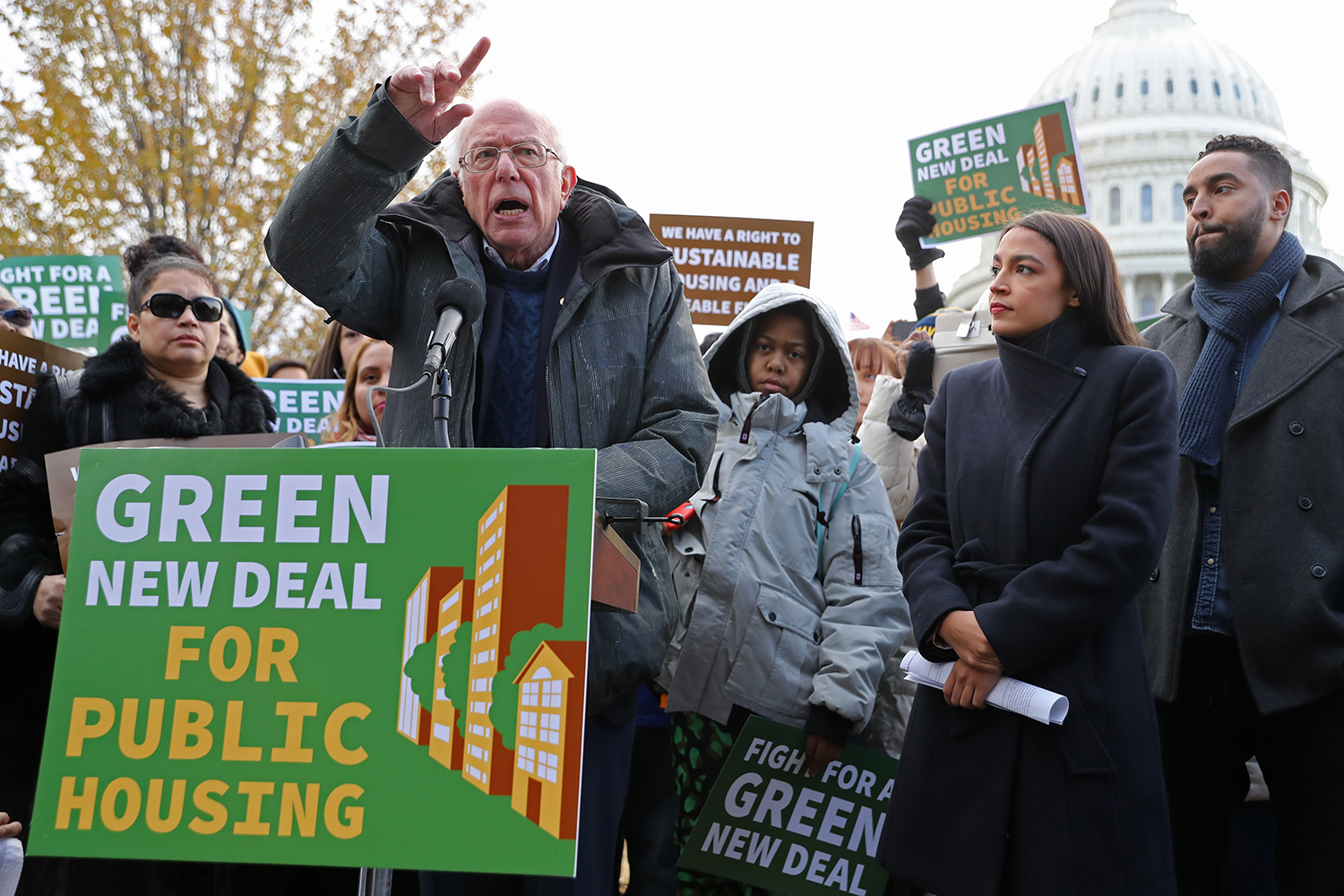 Democratic presidential candidate Sen. Bernie Sanders and U.S. Rep. Alexandria Ocasio-Cortez hold a news conference to introduce legislation to transform public housing as part of their Green New Deal proposal outside the U.S. Capitol on Nov. 14.