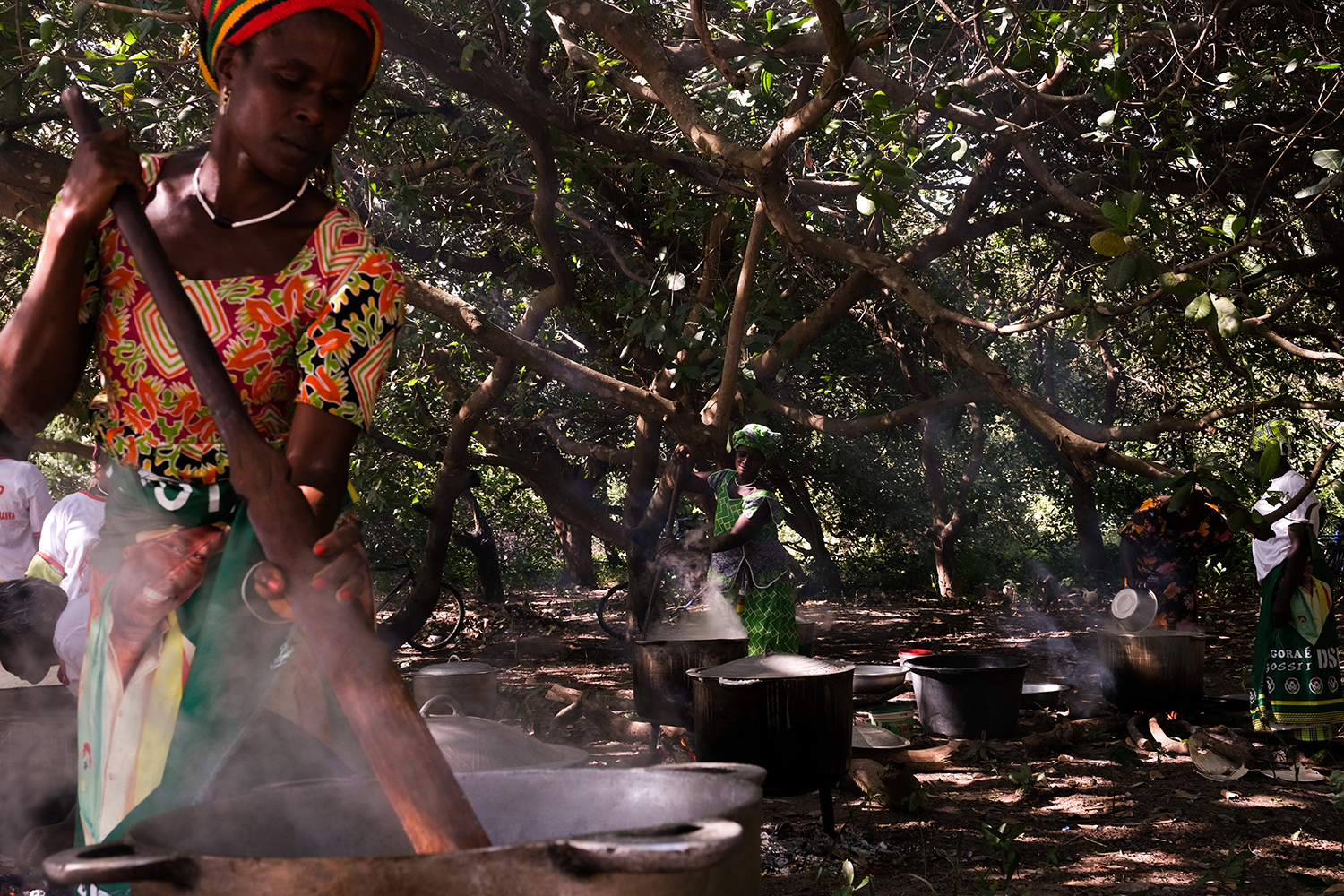 Women make large portions of lunch for campaign workers in the Cacheu region of Guinea Bissau on Nov. 11.
